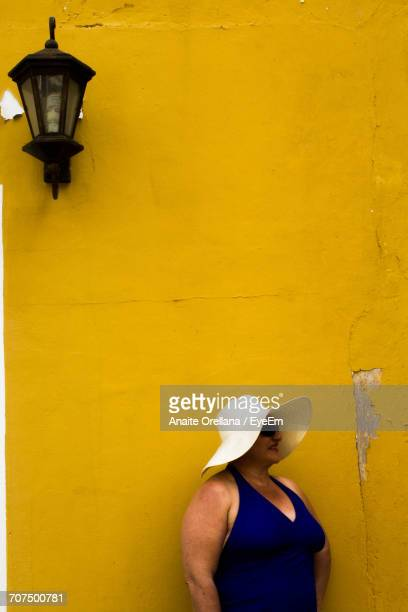 Lamp Against Yellow Wall