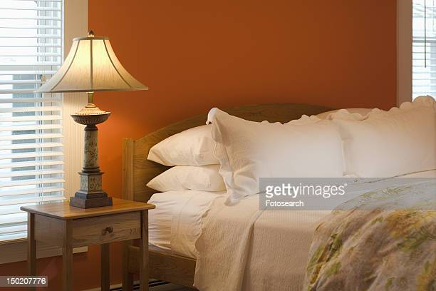 Lamp and nightstand beside bed