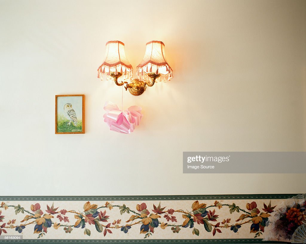Lamp and painting on wall
