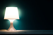 Lamp night light in a dark background. Vintage effect style picture.