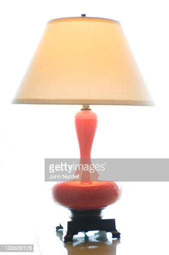 Lamp on a table in a common area in a hotel