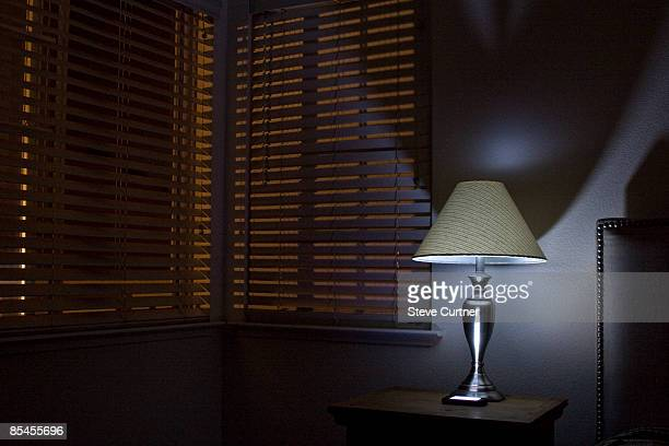Lamp on bedroom nightstand.