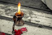 Metal oil lamp for worship.