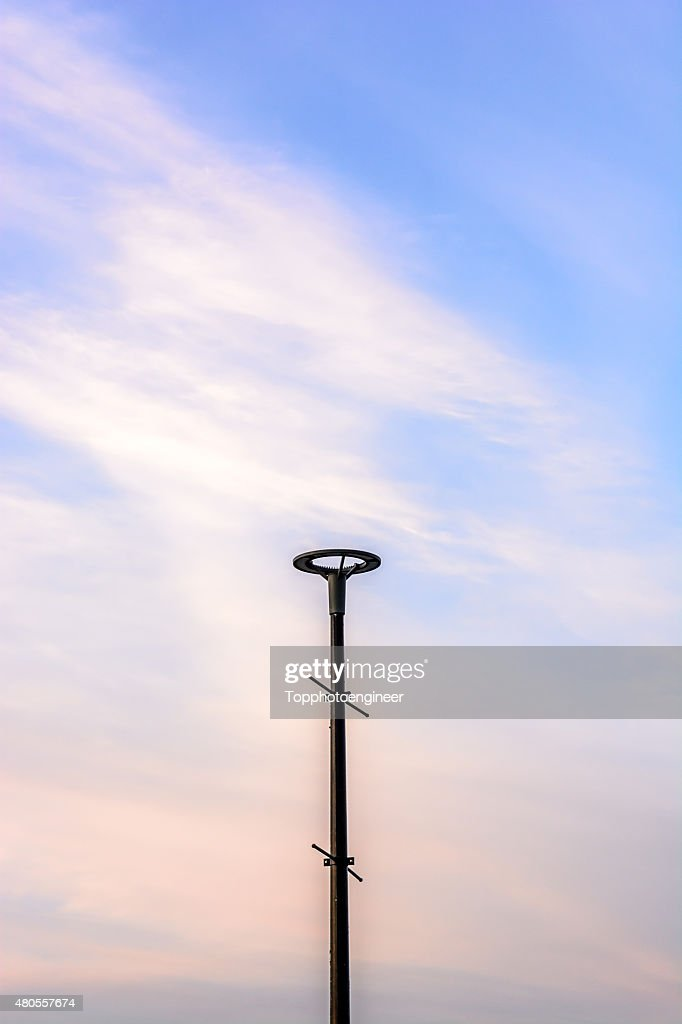 Lamp post on twilight sky : Stock Photo