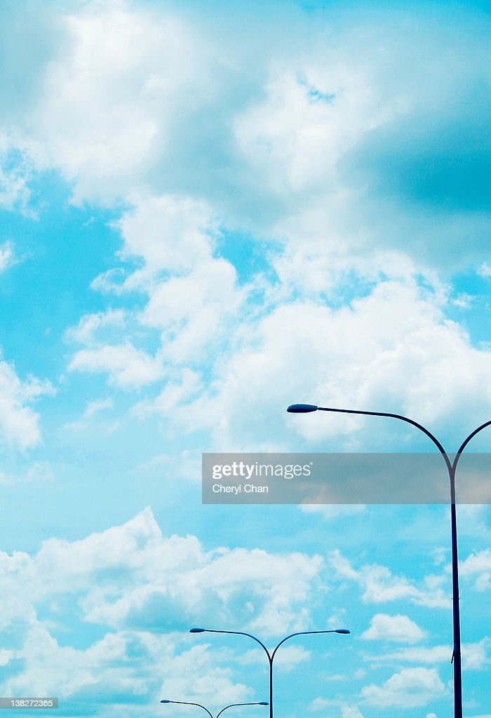 Lamp posts with cloudy sky : Stock Photo