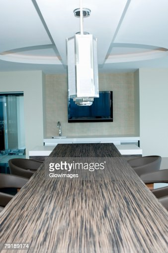 Lamp shade hanging over a table in a hotel : Stock Photo