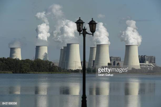 A lamp stands at the waterfront across from cooling towers at the Jaenschwalde coalfired power plant on September 5 2017 in Peitz Germany Germany is...