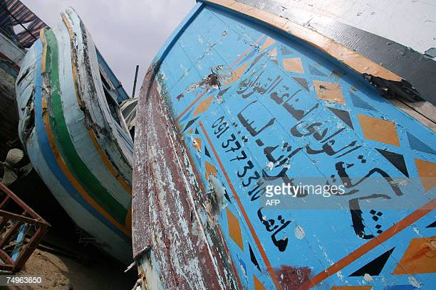 ADDING TRANSLATION OF ARABIC WRITING Picture taken 29 June 2007 shows the wreckage of one of the 160 boats used by illegal immigrants to arrive in...