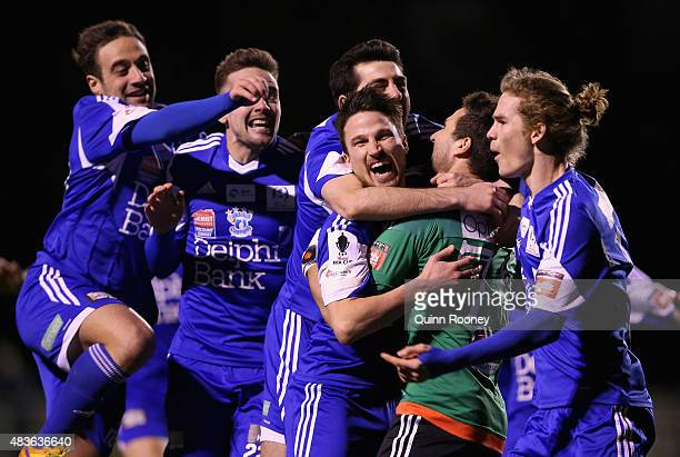 Lampros Honos of the Cannons is congratulated by team mates after kicking the winning goal in the penalty shoot out during the FFA Cup match between...