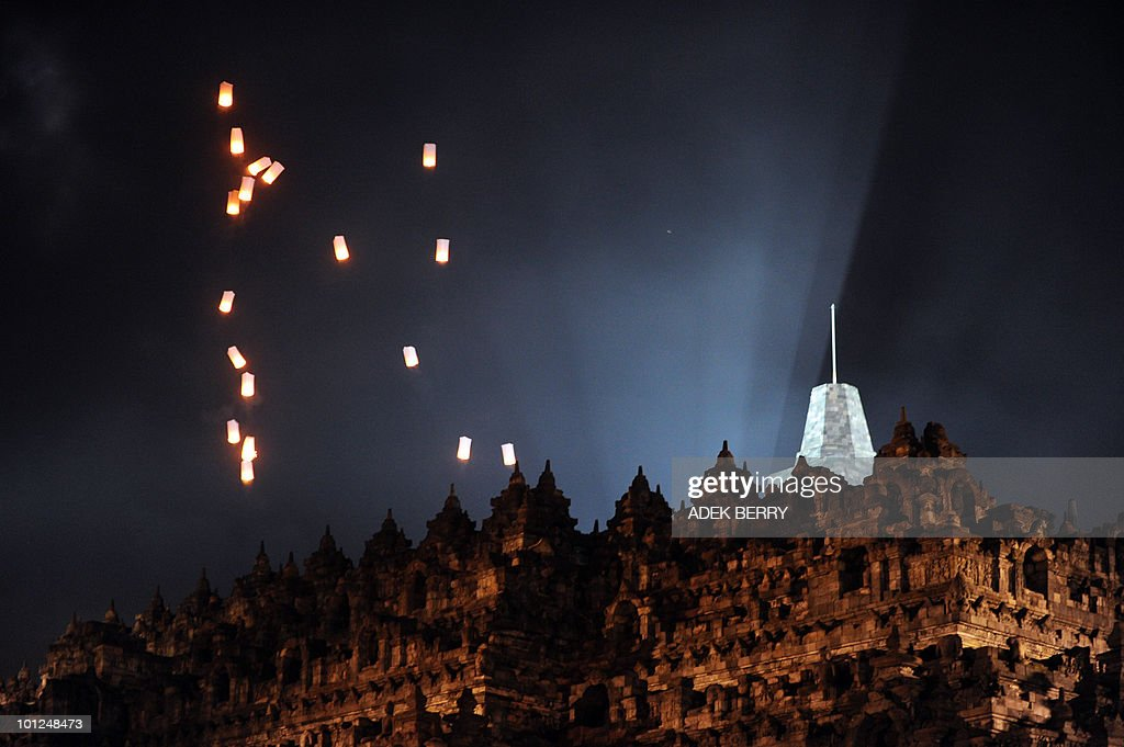 Lamps are seen as Indonesian monks hold prayers during the Vesak festival at the Borobudur temple in Magelang on May 28, 2010. Vesak day is a Buddhist holiday commemorating the birth, enlightement and death of the historical Gautama Buddha, in Indonesia is held on May 28.