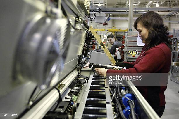 Lan Duong assembles an adjustable frequency drive at the Danfoss Drives manufacturing plant in Rockford Illinois January 6 2004 Danfoss ran just one...