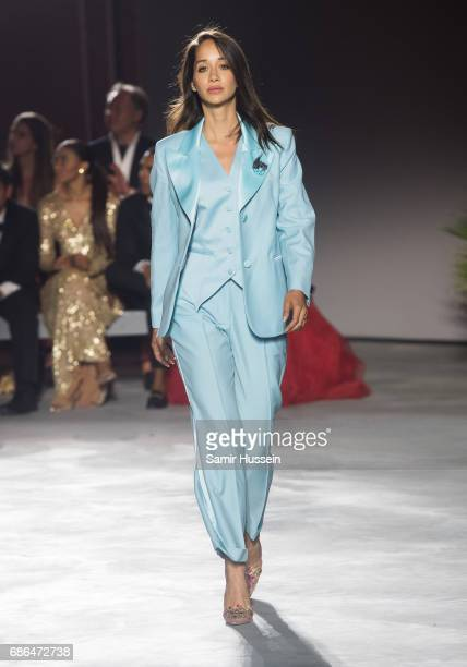 Lana ElSahely walks the runway at the Fashion for Relief event during the 70th annual Cannes Film Festival at Aeroport Cannes Mandelieu on May 21...