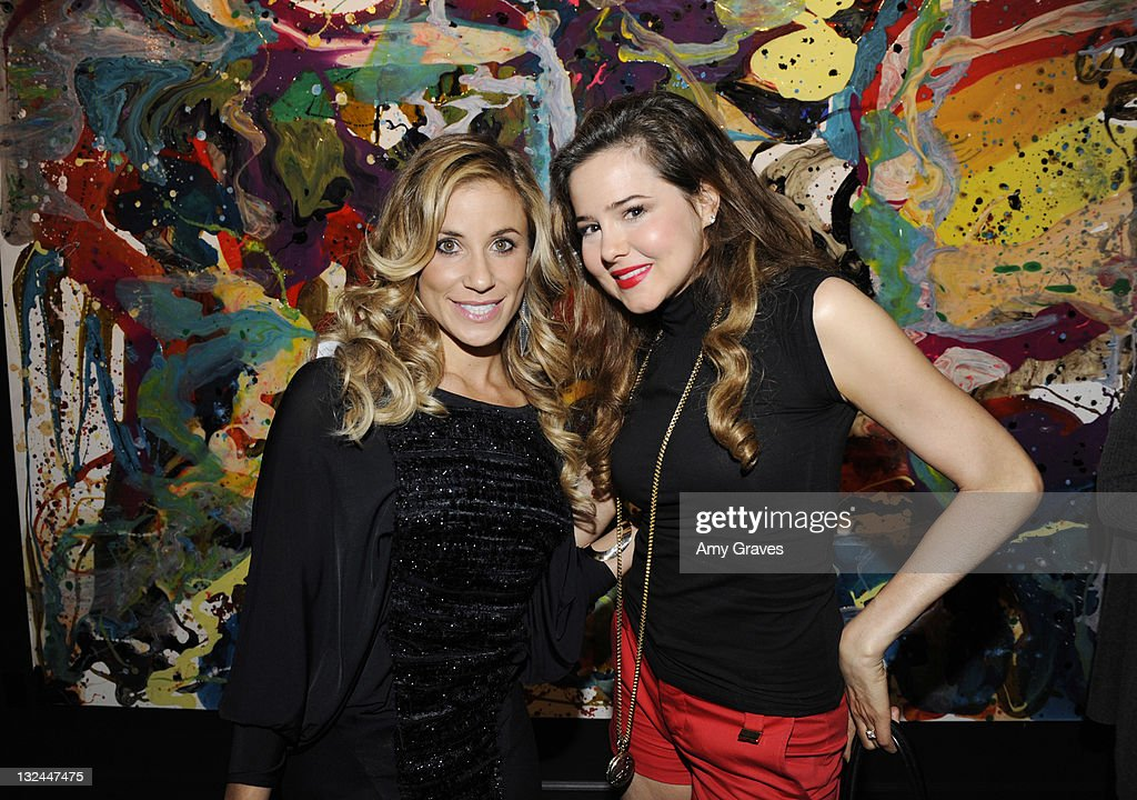 Lana Gomez and Marieh Delfino attend the Lana Gomez Art Show at Roseark on November 11, 2011 in Los Angeles, California.