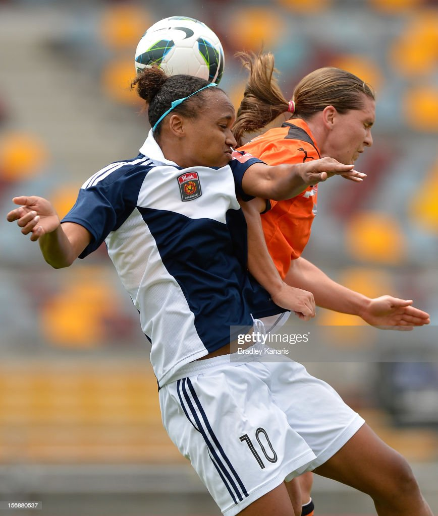 Lana Harch of the Roar and Jessica McDonald of the Victory challenge for the ball during the round six W-League match between the Brisbane Roar and the Melbourne Victory at the Queensland Sport and Athletics Centre on November 24, 2012 in Brisbane, Australia.