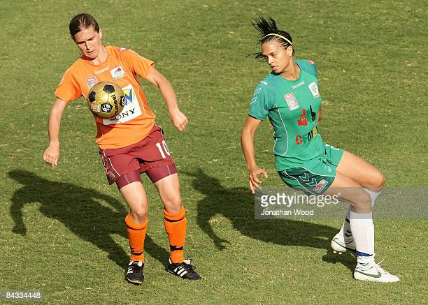 Lana Harch of the Roar controls the ball ahead of Thea Slatyer of Canberra during the WLeague 2009 Grand Final match between the Queensland Roar and...