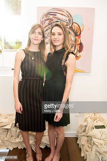 Lana Palumbo and Lauren Regan at the launch of The Dot Project group show 'Distorted Vision' on May 21 2015 in London England