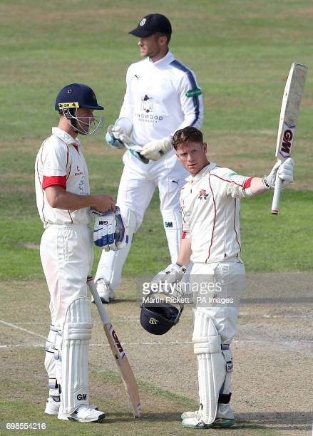 Lancasahire's Alex Davies celebrates making his century against Hampshire during day two of the Specsavers County Championship Division One match at...