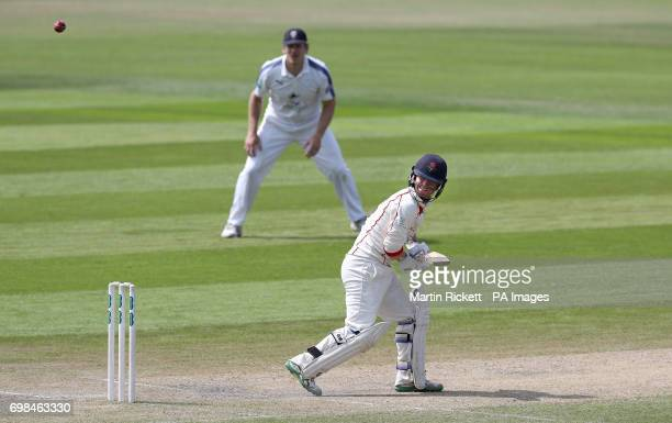 Lancasahire's Alex Davies hits for 4 against Hampshire during day two of the Specsavers County Championship Division One match at the Emirates Old...
