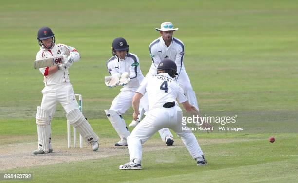 Lancasahire's Alex Davies hits out against Hampshire during day two of the Specsavers County Championship Division One match at the Emirates Old...