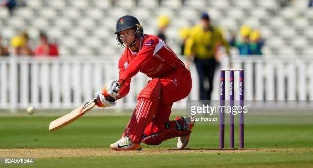 Lancashire batsman Jos Buttler hits out during the Natwest T20 Blast match between Birmingham Bears and Lancashire Lightning at Edgbaston on July 30...