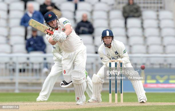 Lancashire batsman Paul Horton hits out watched by wicket keeper Tim Ambrose during the LV County Championship Division One match at the Emirates Old...