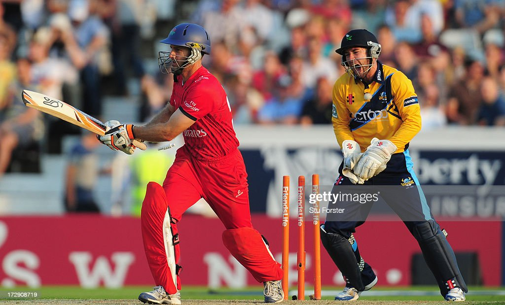 Lancashire batsman <a gi-track='captionPersonalityLinkClicked' href=/galleries/search?phrase=Simon+Katich&family=editorial&specificpeople=176577 ng-click='$event.stopPropagation()'>Simon Katich</a> is bowled as keeper Andy Hodd celebrates during the Friends Life T20 match between Yorkshire Carnegie and Lancashire Lightning at Headingley Carnegie Stadium on July 5, 2013 in Leeds, England.