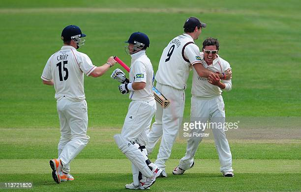 Lancashire bowler Simon Kerrigan celebrates with James Anderson after he had dismissed Warwickshire batsman Ian Bell during day two of the Division...