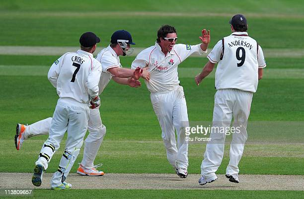 Lancashire bowler Simon Kerrigan celebrates with James Anderson after he had dismissed Warwickshire batsman Mohammad Yousuf during day three of the...