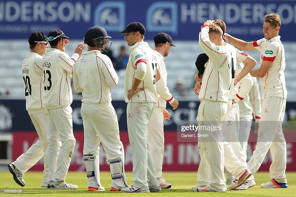 Lancashire celebrate after Adil Rashid of Yorkshire was dismissed during day one of the Specsavers County Championship: Division One match between Yorkshire and Lancashire at Headingley on May 29, 2016 in Leeds, England.