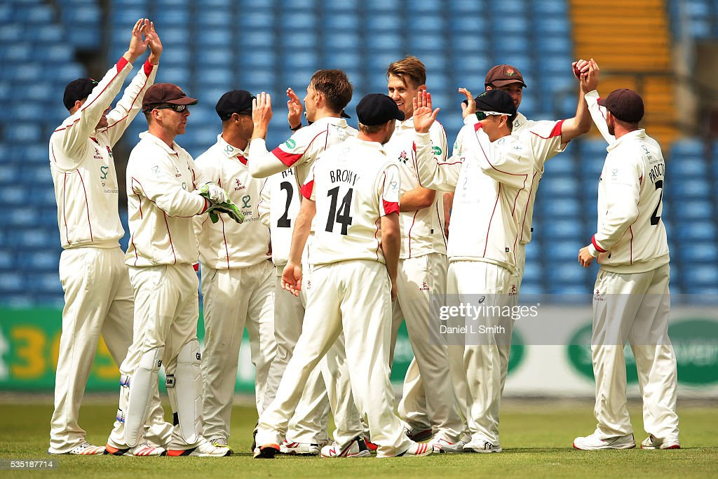 Lancashire celebrate dismissing Alex Lees of Yorkshire during day one of the Specsavers County Championship: Division One match between Yorkshire and Lancashire at Headingley on May 29, 2016 in Leeds, England.