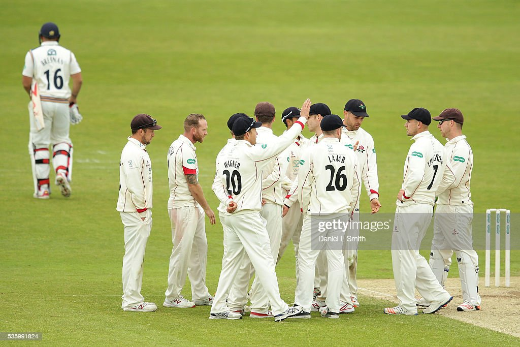 Lancashire celebrate the as <a gi-track='captionPersonalityLinkClicked' href=/galleries/search?phrase=Tim+Bresnan&family=editorial&specificpeople=571509 ng-click='$event.stopPropagation()'>Tim Bresnan</a> of Yorkshire walks off the pitch after a dramatic umpire call during day three of the Specsavers County Championship: Division One match between Yorkshire and Lancashire at Headingley on May 31, 2016 in Leeds, England.