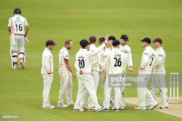 Lancashire celebrate the as Tim Bresnan of Yorkshire walks off the pitch after a dramatic umpire call during day three of the Specsavers County...