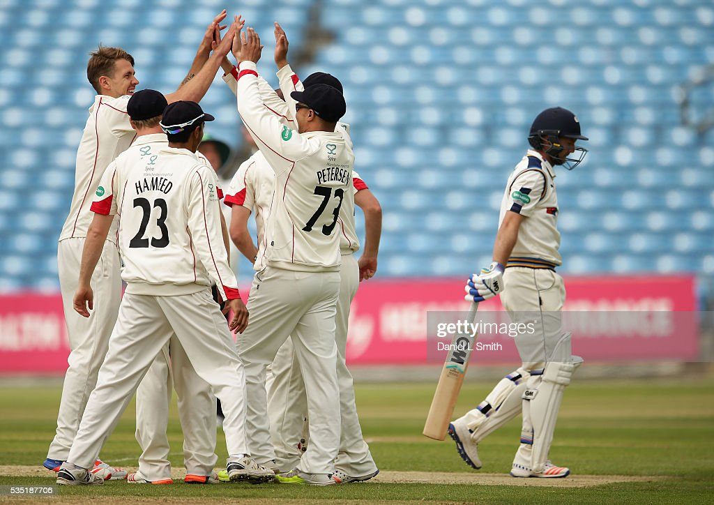 Lancashire celebrate the dismissal of Adma Lyth of Yorkshire during day one of the Specsavers County Championship: Division One match between Yorkshire and Lancashire at Headingley on May 29, 2016 in Leeds, England.