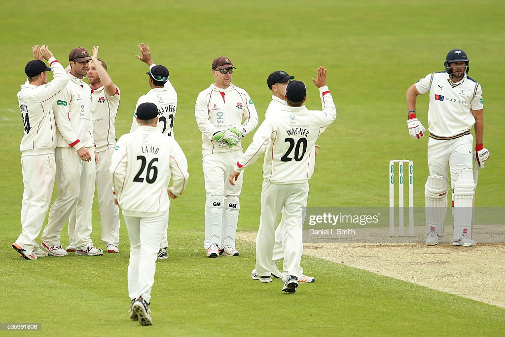 Lancashire celebrate the dismissal of <a gi-track='captionPersonalityLinkClicked' href=/galleries/search?phrase=Tim+Bresnan&family=editorial&specificpeople=571509 ng-click='$event.stopPropagation()'>Tim Bresnan</a> of Yorkshire during day three of the Specsavers County Championship: Division One match between Yorkshire and Lancashire at Headingley on May 31, 2016 in Leeds, England.