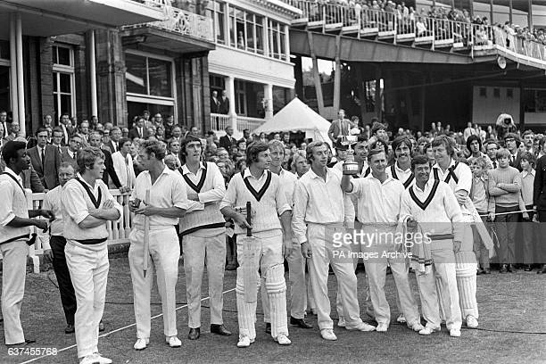 Lancashire celebrate with the Gillette Cup after their fourwicket win Clive Lloyd Jack Simmons David Hughes Frank Hayes Barry Wood David Lloyd Farokh...