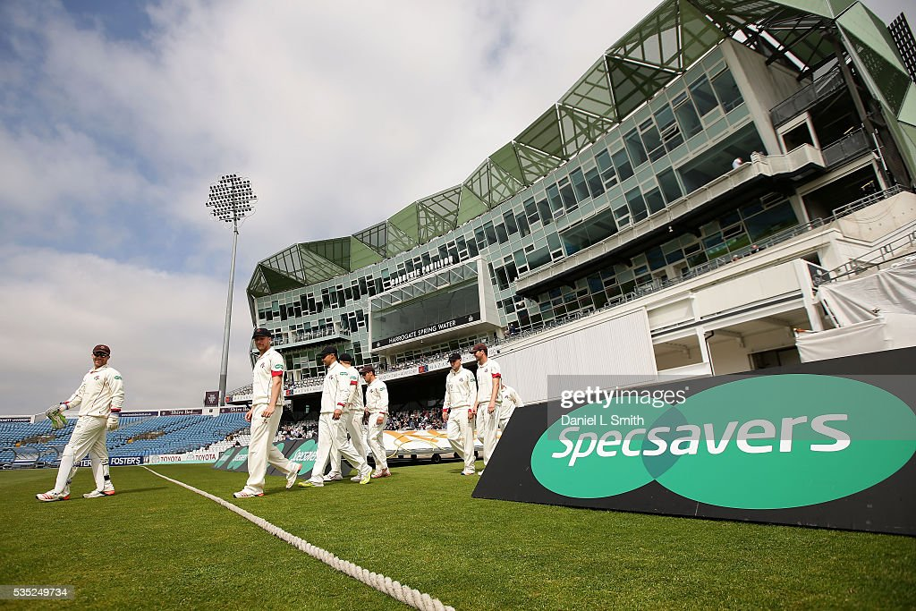 Lancashire County Cricket Club walk out on the the pitch for day one of the Specsavers County Championship: Division One match between Yorkshire and Lancashire at Headingley on May 29, 2016 in Leeds, England.