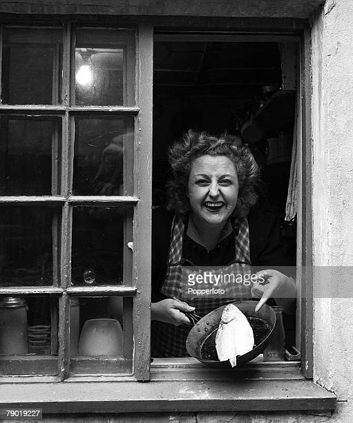 Lancashire England 11th July 1944 Portrait of British entertainer Tessie OShea at home in her cottage in Foulton in the Fylde district Tessie leans...