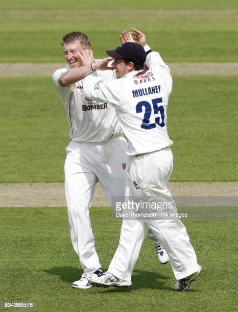 Lancashire Glen Chapple left celebrates with Steven Mullaney after taking the wicket of Somerset's Justin Langer during the LV County Championship...