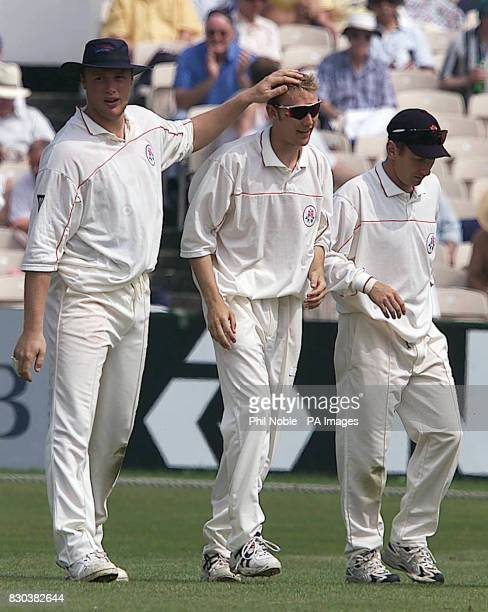 Lancashire leg spinner Chris Schofield gets a pat on the head from team mate Andrew Flintoff after dismissing Durham's Simon Katich during the Benson...
