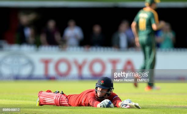 Lancashire Lightning's Alex Davies looks to the umpire before hes given run out after a review