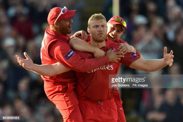 CROP** Lancashire Lightning's Andrew Flintoff celebrates with Ashwell Prince and Steven Croft after taking the wicket of Birmingham Bears' Ian Bell...