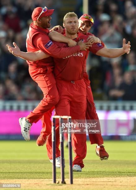 Lancashire Lightning's Andrew Flintoff celebrates with Ashwell Prince and Steven Croft after taking the wicket of Birmingham Bears' Ian Bell with his...