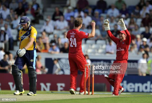 Lancashire Lightning's Tom Smith celebrates with teammate Gareth Cross after he takes the wicket of Yorkshire Vikings' Andrew Gale