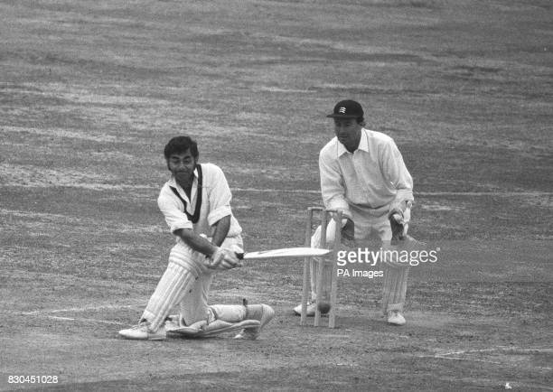 Lancashire opener Farokh Engineer attempts to sweep a delivery from Norman featherstone of Middlesex during the final day's play at Lord's of three...