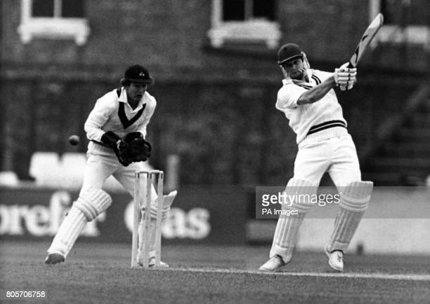 Lancashire wicketkeeper John Stanworth poised for action as Surrey batsman Trevor Jesty delivers a ball