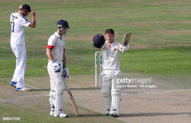 Lancashire's Alex Davies celebrates making his century against Hampshire during day two of the Specsavers County Championship Division One match at...