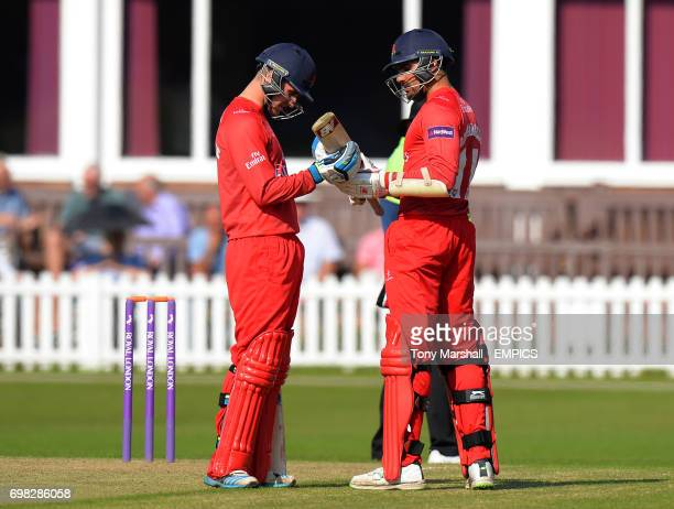 Lancashire's Andrea Agathangelou inspects his bat with Liam Livingstone during the 2nd XI Trophy Final