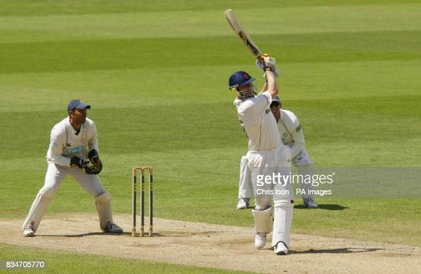 Lancashire's Andrew Flintoff hits a six off the final ball to secure their victory during the Liverpool Victoria County Championship match at the...