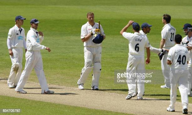 Lancashire's Andrew Flintoff removes his helmet following their victory during the Liverpool Victoria County Championship match at the Rose Bowl...