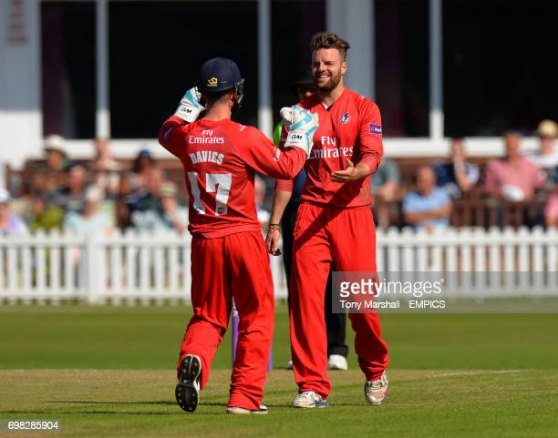 Lancashire's Arron Lilley celebrates with Alex Davies after taking the wicket of Leicestershire's Shiv Thakor the 2nd XI Trophy Final